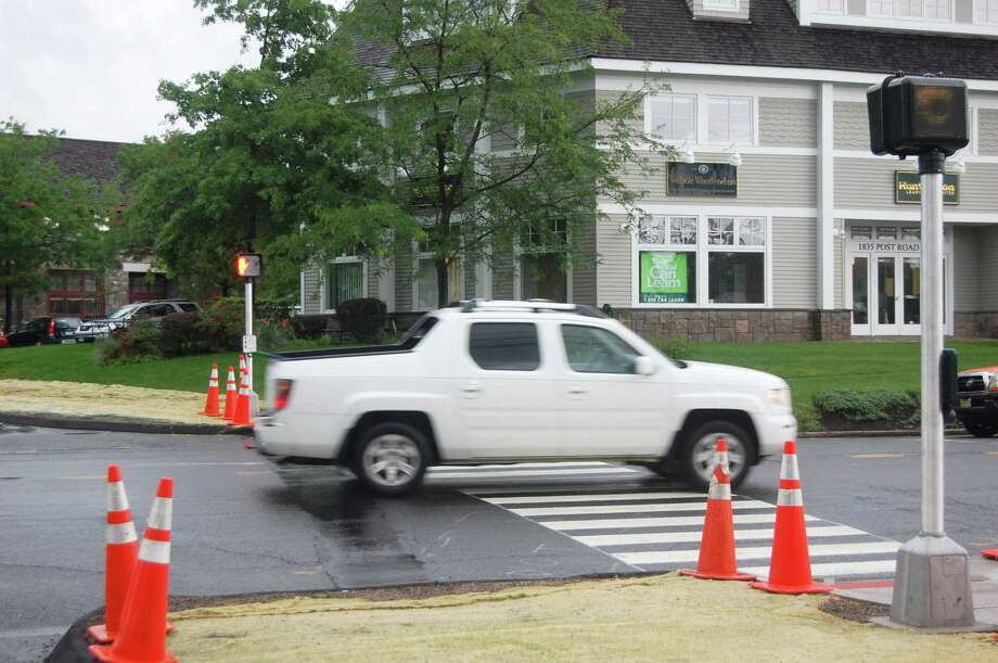 A truck passes through the new cross walk near the Shake Shack restaurant, a stretch of roadway that has seen several pedestrian fatalities in recent years. Photo: Cameron Martin / Westport News