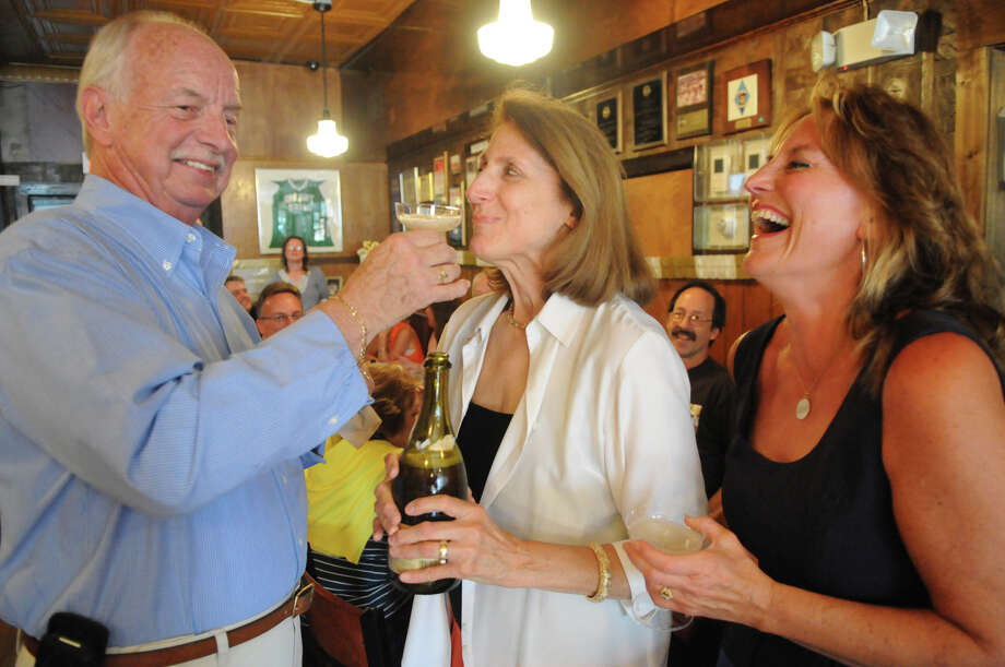 Vicki and Mike Moon and their daughter Rachel Ozimek indulge in champagne as they celebrate the Moon's 50th anniversary at the Colony Grill, where they met and have frequented throughout their marriage, on Myrtle Avenue in Stamford, Conn., June 15, 2013. Photo: Keelin Daly / Stamford Advocate Freelance