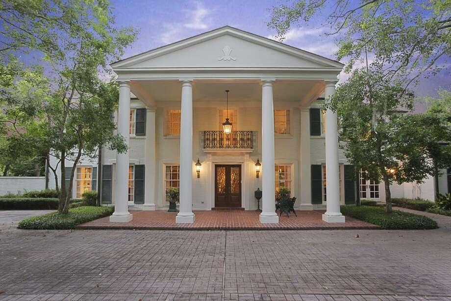 This Colonial-style home sits on one and half acres of prime property in Houston. The home features four bedrooms and six bathrooms in more than 8,800 square feet of living space. Photo: HAR