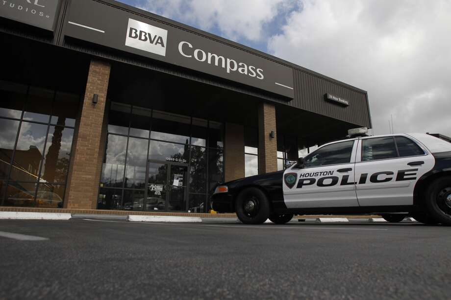 Police investigate an attempted bank robbery in the 12600 block of Memorial Drive in Houston, June 17, 2013. (Cody Duty / Houston Chronicle)