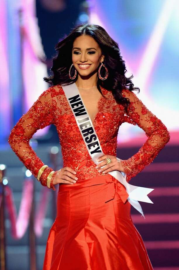 Miss New Jersey USA Libell Duran walks onstage during the 2013 Miss USA pageant at PH Live at Planet Hollywood Resort & Casino on June 16, 2013 in Las Vegas, Nevada.