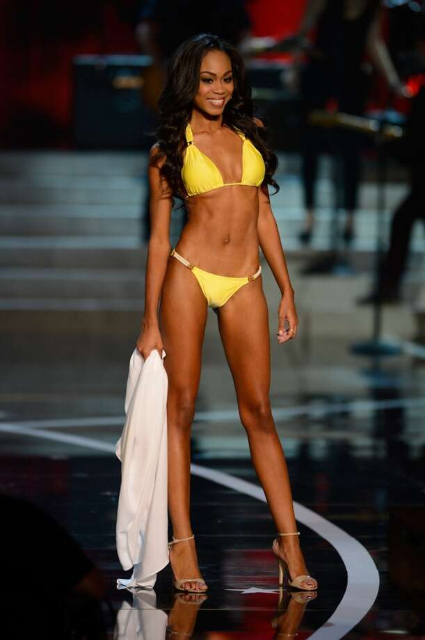 Miss North Carolina Ashley Love-Mills walks the runway during the swimsuit competition of the Miss USA 2013 pageant, Sunday, June 16, 2013, in Las Vegas.