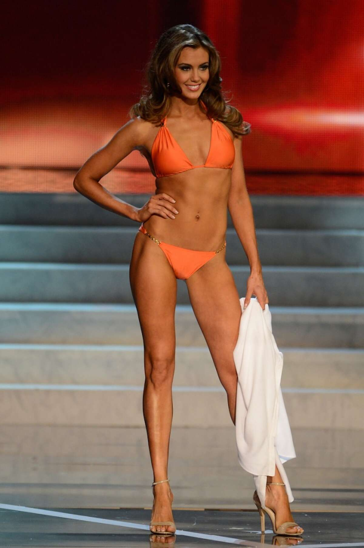 Miss Connecticut Erin Brady walks the runway during the swimsuit competition of the Miss USA 2013 pageant, Sunday, June 16, 2013, in Las Vegas.