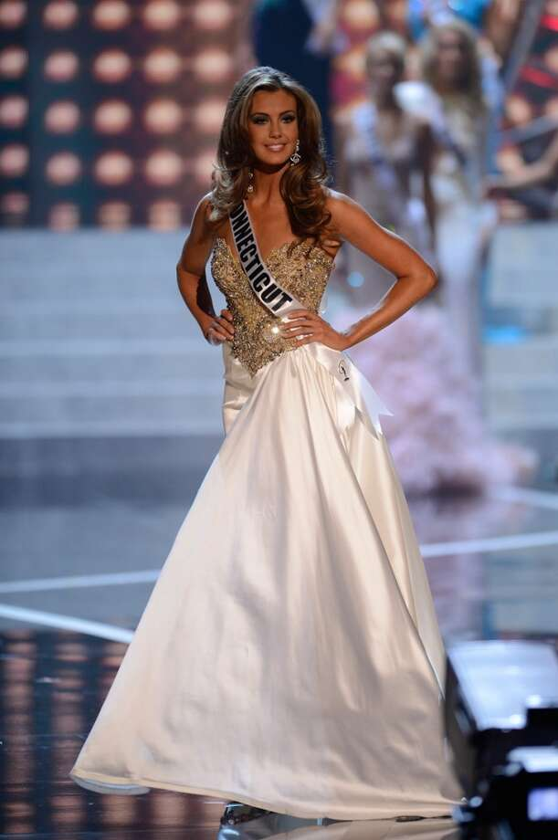 Miss Connecticut USA Erin Brady poses onstage during evening gown portion of the Miss USA 2013 pageant, Sunday, June 16, 2013, in Las Vegas.