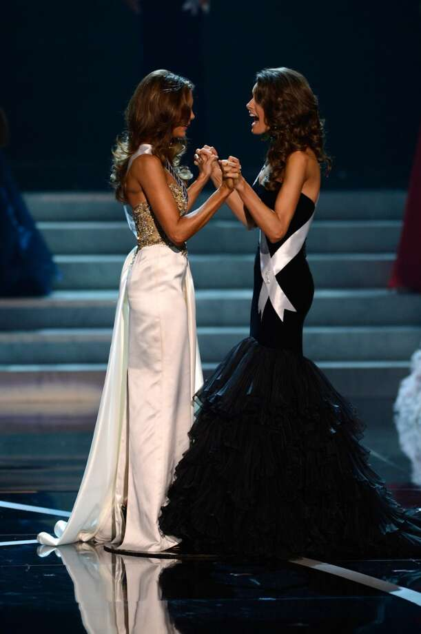 From left, Miss Connecticut Erin Brady waits onstage with Miss Alabama Mary Margaret McCord for the announcement of the crowning of the Miss USA 2013 pageant, Sunday, June 16, 2013, in Las Vegas.