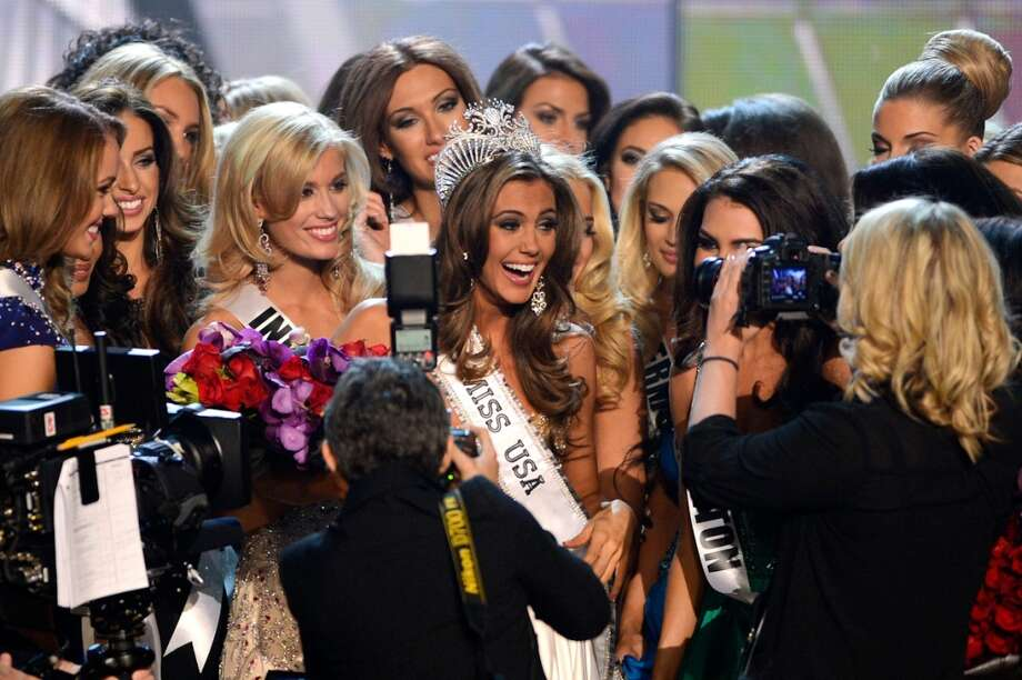 Miss Connecticut USA Erin Brady is congratulated by contestants after being crowned Miss USA during the Miss USA 2013 pageant, Sunday, June 16, 2013, in Las Vegas.