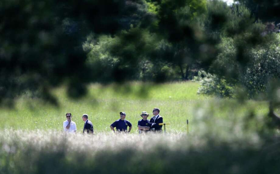 Investigators look over the scene in Oakland Township, Mich., Monday, June 17, 2013, where officials search for the remains of Teamsters union president Jimmy Hoffa who disappeared from a Detroit-area restaurant in 1975. (AP Photo/Carlos Osorio) Photo: Carlos Osorio