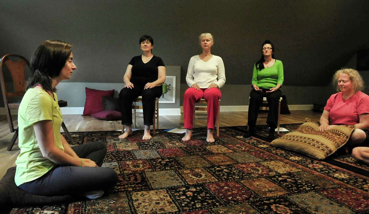 Teacher Rachel Andrews leads a class in psychic development for beginners at Sound, in Newtown, Conn. Sunday, June 16, 2013.