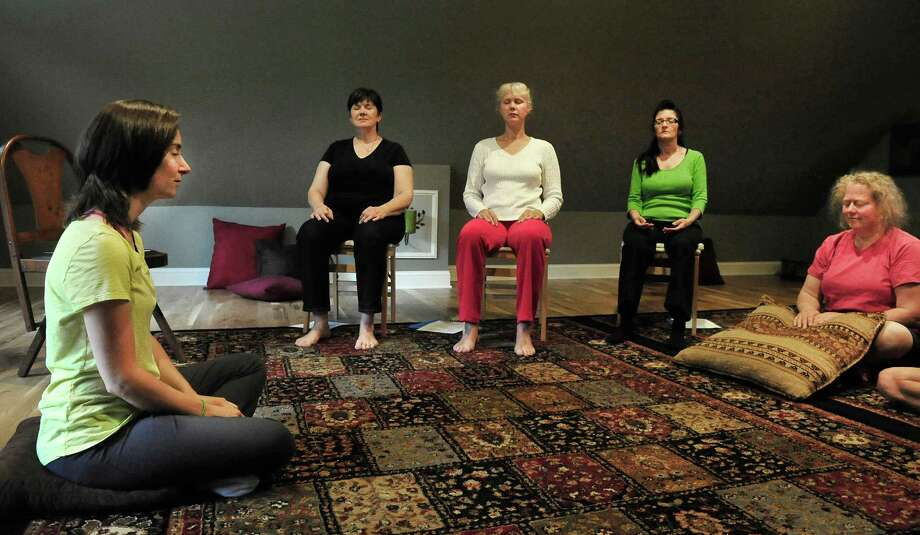Teacher Rachel Andrews leads a class in psychic development for beginners at Sound, in Newtown, Conn. Sunday, June 16, 2013. Photo: Michael Duffy / The News-Times