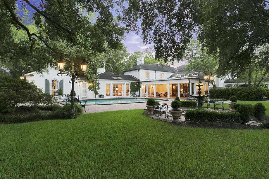 This Colonial-style home sits on one and half acres of prime property in Houston. The home features four bedrooms and six bathrooms in more than 8,800 square feet of living space.
