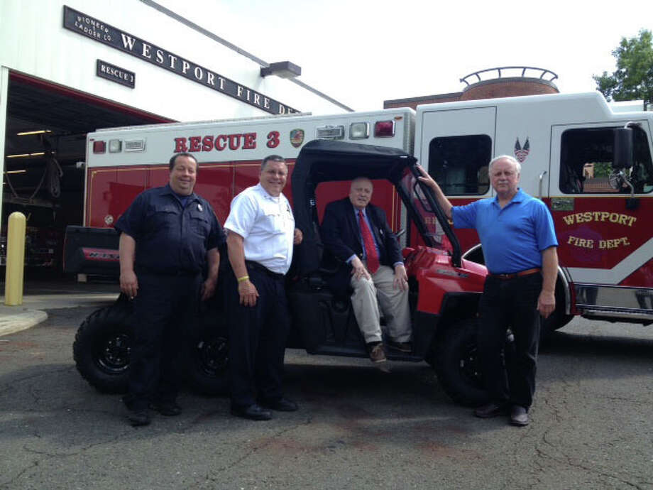 From left to right, mechanic Tim Reilly, Deputy Chief Robert Kepchar, First Selectman Gordon Joseloff, Steve Lobdell. Photo: Submitted Photo, Cameron Martin / Westport News