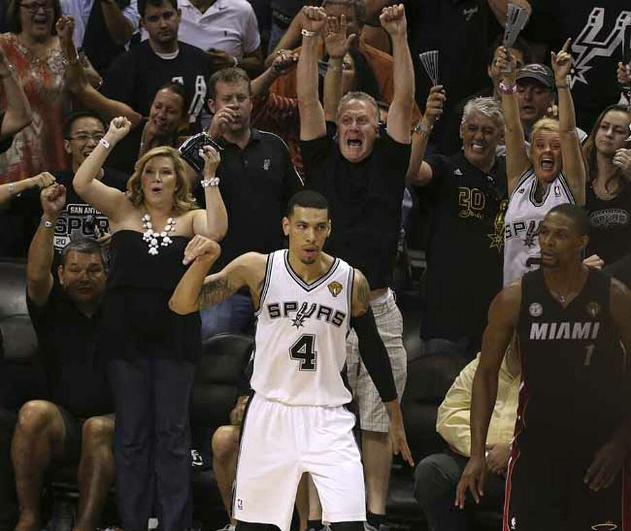 San Antonio Spurs' Danny Green reacts after sinking the his last three-pointer as Miami Heat's Chris Bosh reacts during the second half of Game 5 of the NBA Finals at the AT&T Center on Sunday, June 16, 2013. Photo: Jerry Lara, San Antonio Express-News / ©2013 San Antonio Express-News