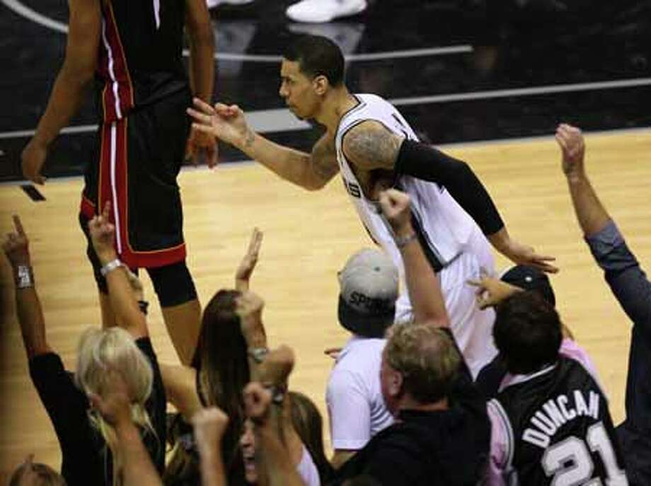 SAN ANTONIO, TX - JUNE 16:  Danny Green #4 of the San Antonio Spurs reacts after making a three-pointer in the fourth quarter against the Miami Heat during Game Five of the 2013 NBA Finals at the AT&T Center on June 16, 2013 in San Antonio, Texas. NOTE TO USER: User expressly acknowledges and agrees that, by downloading and or using this photograph, User is consenting to the terms and conditions of the Getty Images License Agreement. Photo: Mike Ehrmann, Getty Images / 2013 Getty Images