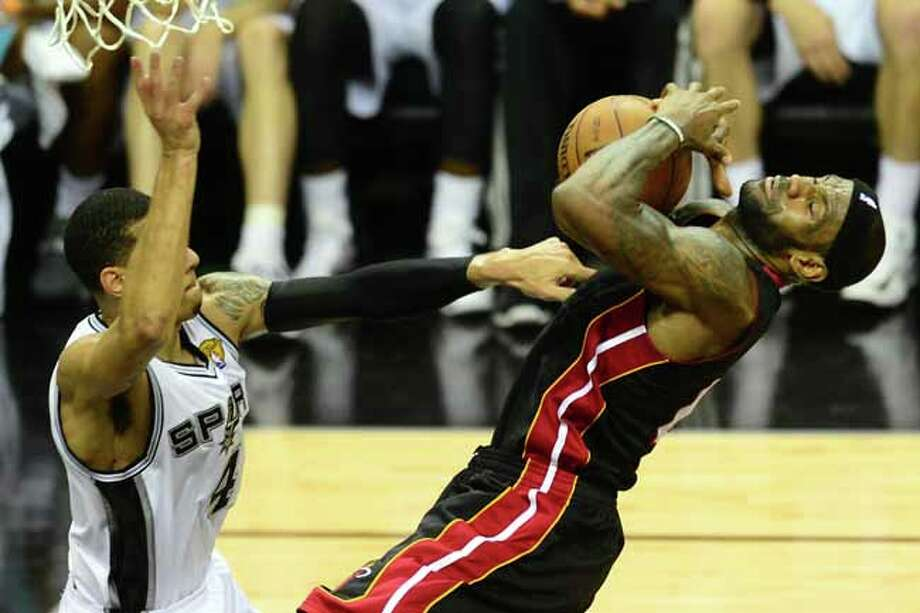 Danny Green of the San Antonio Spurs stops LeBron James of the Miami Heat from getting to the basket during game 5 of the NBA finals on June 16, 2013 in San Antonio, Texas., where the Spurs defeated the Heat 114-104 and now lead the series 3-2. AFP PHOTO/Frederic J. BROWNFREDERIC J. BROWN/AFP/Getty Images Photo: FREDERIC J. BROWN, AFP/Getty Images / AFP