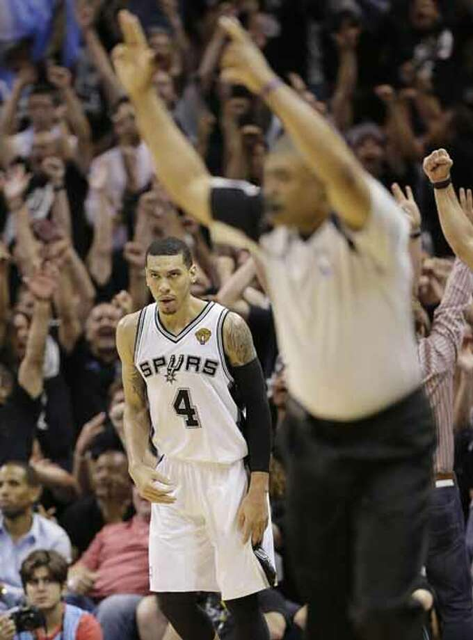San Antonio Spurs' Danny Green (4) scores a three-point basket against the Miami Heat during the second half at Game 5 of the NBA Finals basketball series, Sunday, June 16, 2013, in San Antonio. (AP Photo/Eric Gay) Photo: Eric Gay, Associated Press / AP