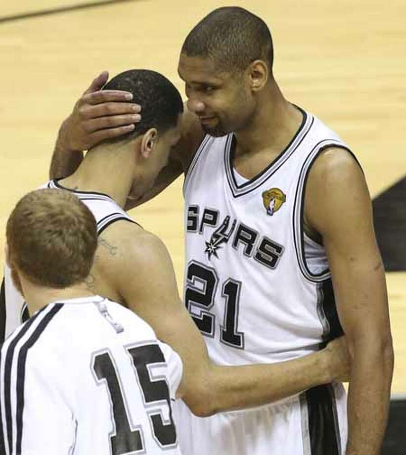 San Antonio Spurs' Tim Duncan hugs Danny Green after Green scored his last record-setting three point shot during the second half of the Spurs 114-104 win over the Miami Heat during Game 5 of the NBA Finals at the AT&T Center on Sunday, June 16, 2013. Photo: Jerry Lara, San Antonio Express-News / ©2013 San Antonio Express-News