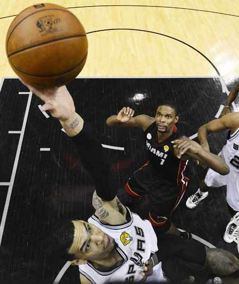 San Antonio Spurs' Danny Green attempts a shot against the Miami Heat during the second half at Game 5 of the NBA Finals basketball series, Sunday, June 16, 2013, in San Antonio. The Spurs won 114-104. (AP Photo/John G. Mabanglo, Pool) Photo: John G. Mabanglo, Associated Press / EPA Pool