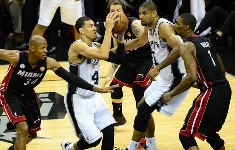 Danny Green of the San Antonio Spurs drives to the basket under pressure from Ray Allen, Mike MIller and Chris Bosh of the Miami Heat as Tim Duncan gets in the mix during game 5 of the NBA finals on June 16, 2013 in San Antonio, Texas., where the Spurs defeated the Heat 114-104 and now lead the series 3-2. AFP PHOTO/Frederic J. BROWNFREDERIC J. BROWN/AFP/Getty Images Photo: FREDERIC J. BROWN, AFP/Getty Images / AFP
