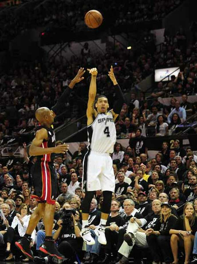 Danny Green of the San Antonio Spurs shoots a three-pointer under pressure from Ray Allen of the Miami Heat during game 5 of the NBA finals on June 16, 2013 in San Antonio, Texas., where the Spurs defeated the Heat 114-104 and now lead the series 3-2. AFP PHOTO/Frederic J. BROWNFREDERIC J. BROWN/AFP/Getty Images Photo: FREDERIC J. BROWN, AFP/Getty Images / AFP