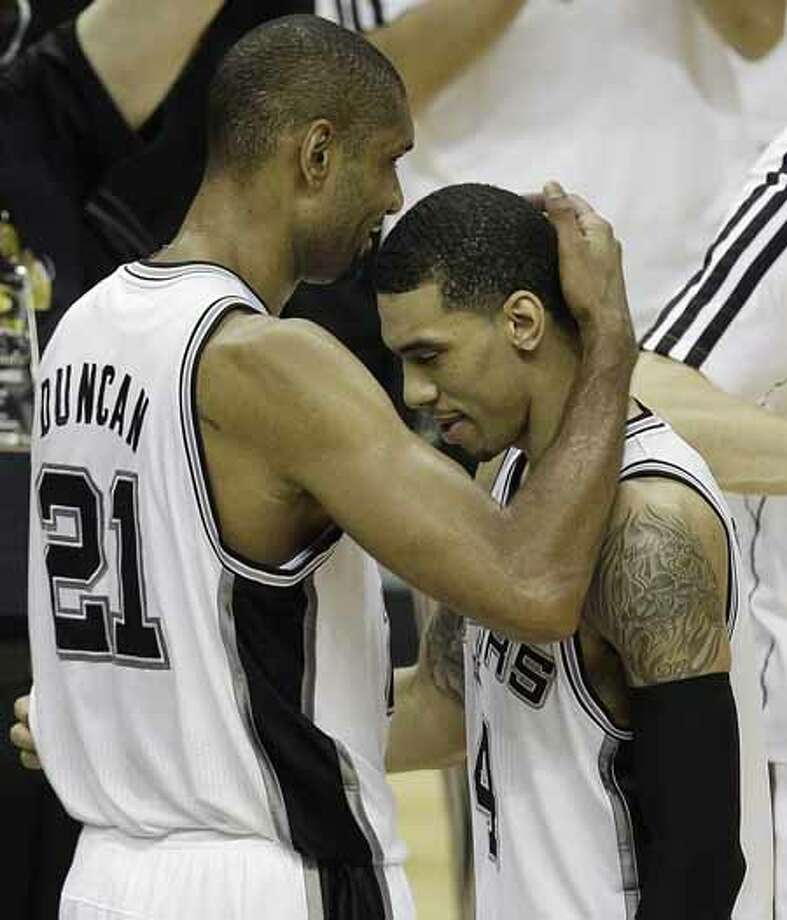 San Antonio Spurs' Tim Duncan (21) embraces Danny Green during the second half at Game 5 of the NBA Finals basketball series, against the Miami Heat, Sunday, June 16, 2013, in San Antonio. (AP Photo/David J. Phillip) Photo: David J. Phillip, Associated Press / AP