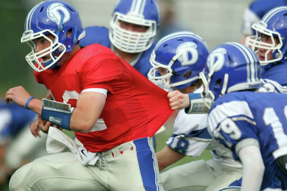 Darien QB Silas Wyper stretches for yardage during the annual Blue & White football game at Darien Stadium, June 16th, 2013. Photo: J. Gregory Raymond / Stamford Advocate Freelance;  © J. Gregory Raymond