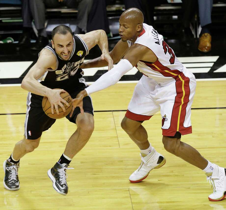 Spurs guard Manu Ginobili tries to maneuver around the Miami  Heat's Ray Allen in Game 2 of the NBA Finals. A reader views the contest as a metaphorical struggle between commercialism and principles. Photo: Wilfredo Lee, Associated Press / AP