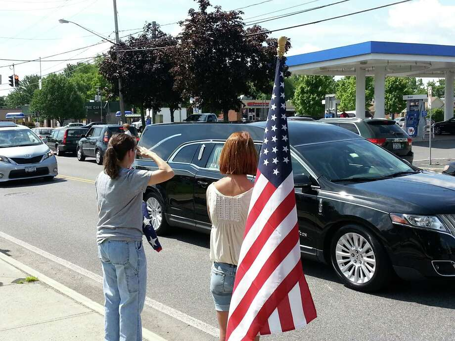 Air Force veteran Michelle Sanchez and her daughter, Kameryn Sanchez, both of Delmar, attended Monday's motorcade for Lt. Col. Todd Clark at the corner of Wolf and Sand Creek roads. (Dennis Yusko / Times Union)