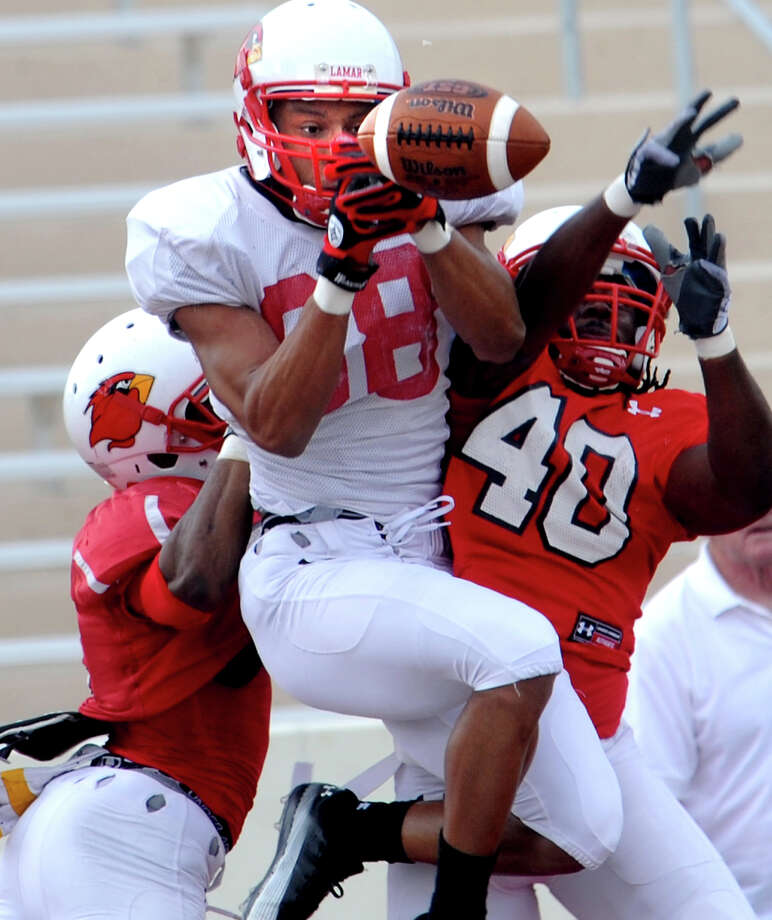 Jordan Edwards almost makes a touchdown catch but is prevented Branden Thomas and Jeremiah Alexander during the Spring Scrimmage at the Provost Umphrey Stadium at Lamar University in Beaumont, Saturday. Tammy McKinley/The Enterprise Photo: TAMMY MCKINLEY