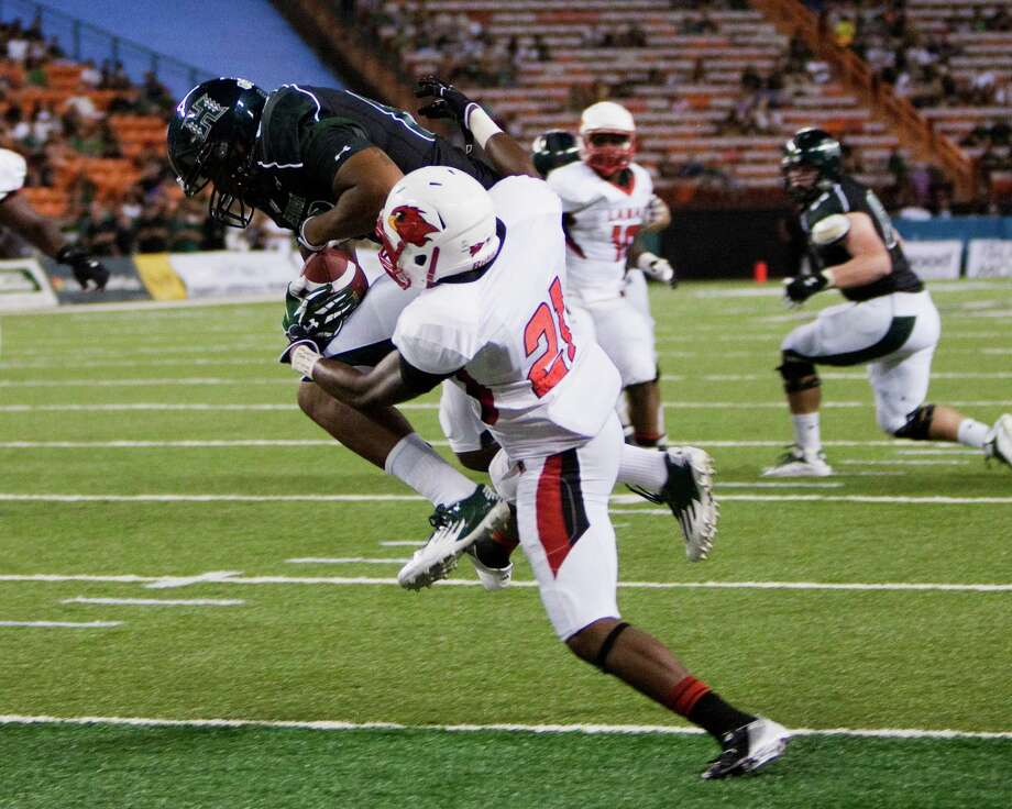 Hawaii wide receiver Darius Bright pulls in a touchdown pass over Lamar defensive back Branden Thomas during the second quarter of the NCAA game between the Lamar and Hawaii, Sept. 15, 2012 in Honolulu.  (AP Photo/Marco Garcia) Photo: Marco Garcia, FRE / FR132415 AP