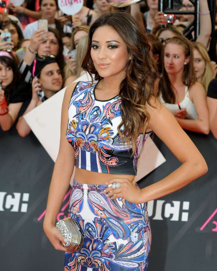 TORONTO, ON - JUNE 16:  Shay Mitchell arrives on the red carpet at the 2013 MuchMusic Video Awards at Bell Media Headquarters on June 16, 2013 in Toronto, Canada.  (Photo by Jag Gundu/Getty Images)