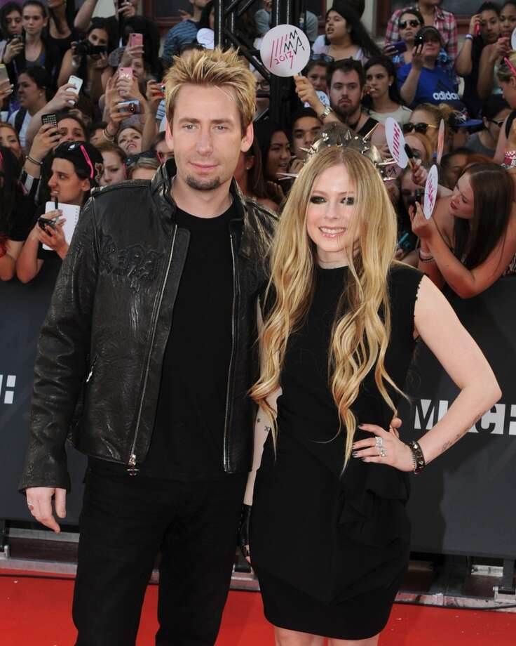 TORONTO, ON - JUNE 16:  Chad Kroeger and Avril Lavigne arrive on the red carpet at the 2013 MuchMusic Video Awards at Bell Media Headquarters on June 16, 2013 in Toronto, Canada.  (Photo by Jag Gundu/Getty Images)