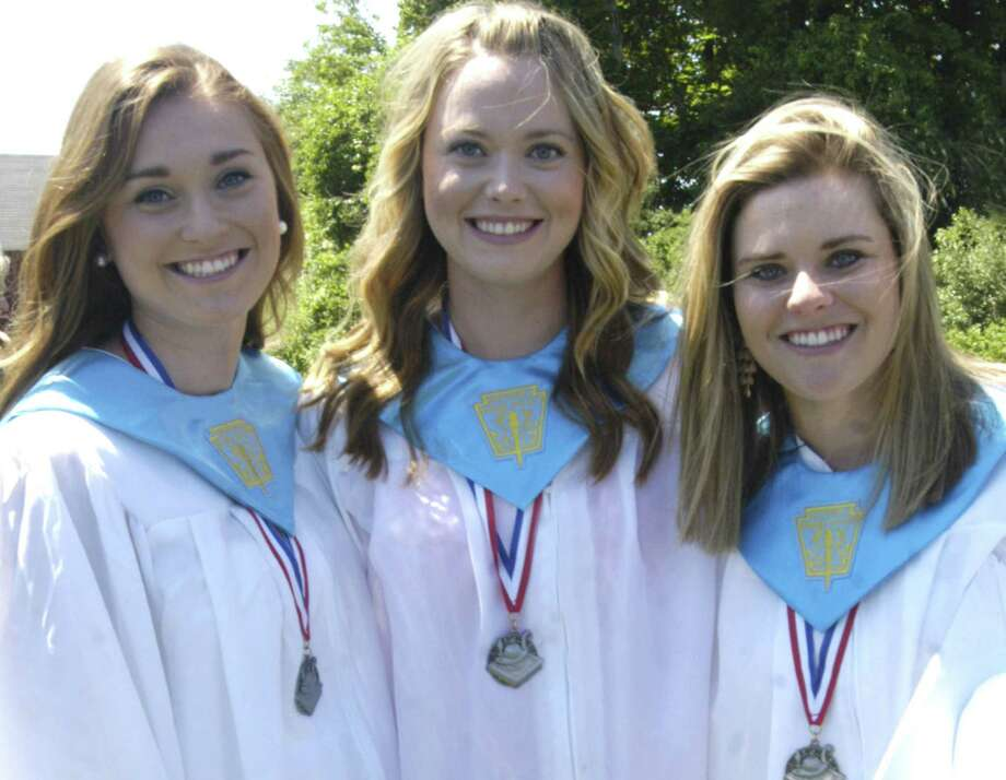 Happily posing for a friend's camera after Shepaug Valley High School's commencement ceremony for the Class of 2013 are sisters, from the left, Hannah, Emma and Mia Landegren. June 15, 2013 Photo: Norm Cummings
