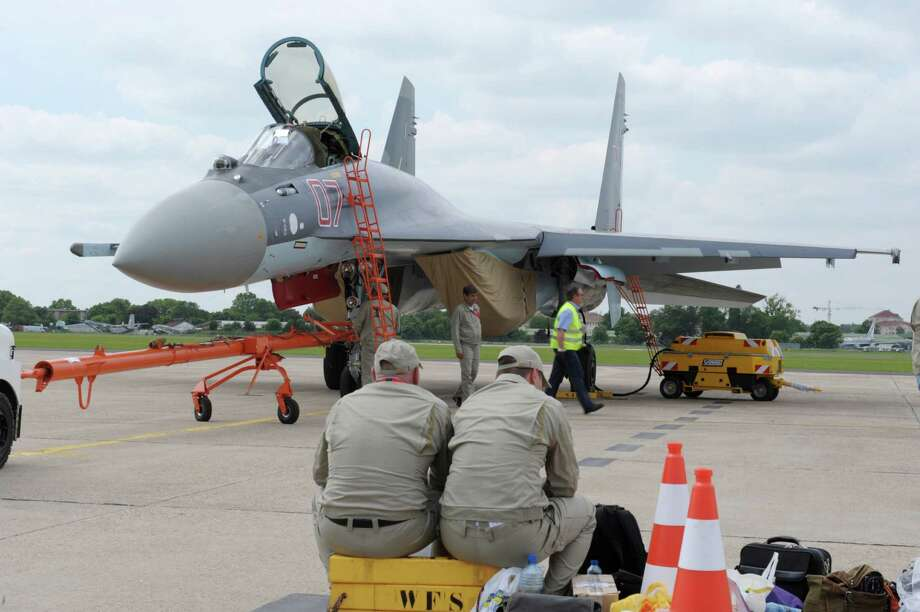 Russian technicians work in front of the Sukhoi SU-35 on the tarmac of Le Bourget on June 14 2013.  Photo: AFP, AFP/Getty Images / 2013 AFP