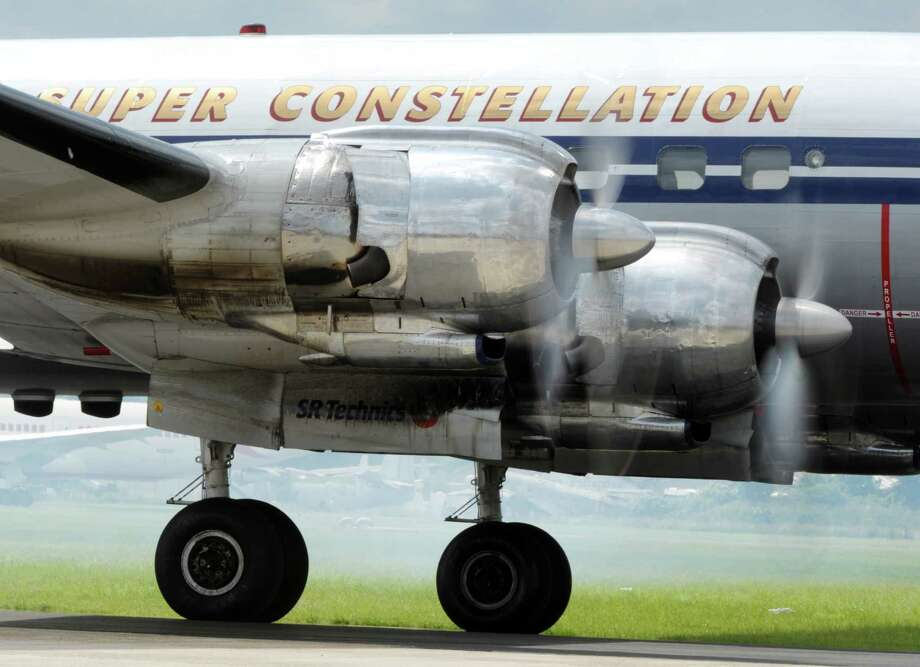 The engine of a Lockheed Super Constellation plane is seen as the aircraft readies for take-off prior to a demonstration flight at the Le Bourget Air show, outside Paris, on June 14. Photo: AFP, AFP/Getty Images / 2013 AFP