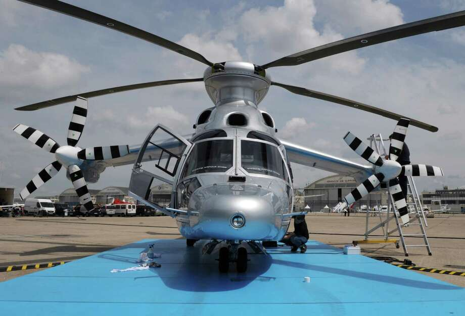 Technicians prepare a Eurocopter X3 helicopter at the Le Bourget Air show, outside Paris, on June 14.  Photo: AFP, AFP/Getty Images / 2013 AFP
