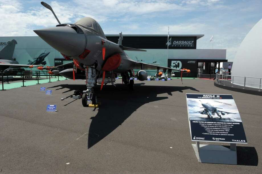 A Rafale is on display near the Dassault Aviation chalet at Le Bourget on June 16, 2013, on the eve of the opening of  the International Paris Air show. Photo: AFP, AFP/Getty Images / 2013 AFP