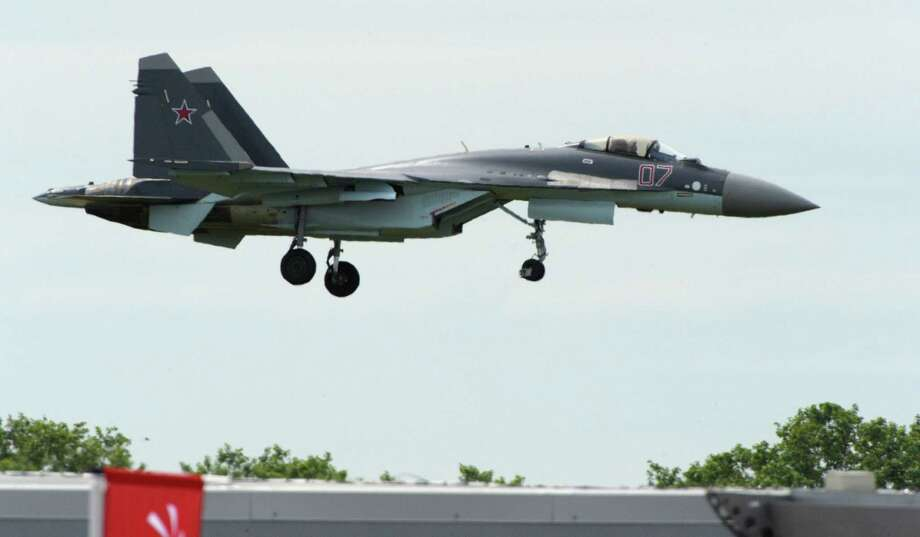 The Russian-made Sukhoi SU-35 military jet lands after its preparation flying display at Le Bourget on June 16, 2013, on the eve of the opening of  the Paris Air show.  Photo: AFP, AFP/Getty Images / 2013 AFP