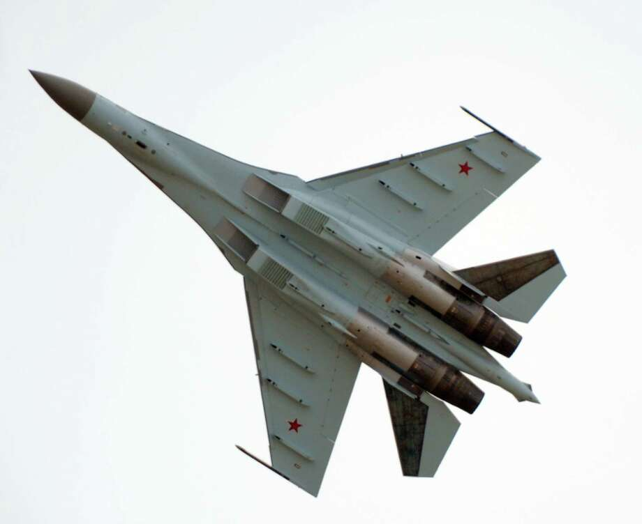 The pilot of a Russian-made Sukhoi SU-35 military jet presents his flying display during a preparation at  Le Bourget on June 16, 2013, on the eve of the opening of  the Paris Air show. Photo: AFP, AFP/Getty Images / 2013 AFP