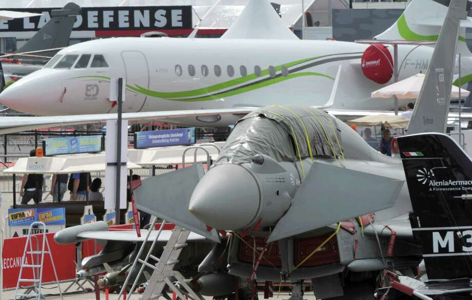 Planes are on display at Le Bourget airport on June 16, 2013, on the eve of the opening of  the Paris Air show. Photo: AFP, AFP/Getty Images / 2013 AFP
