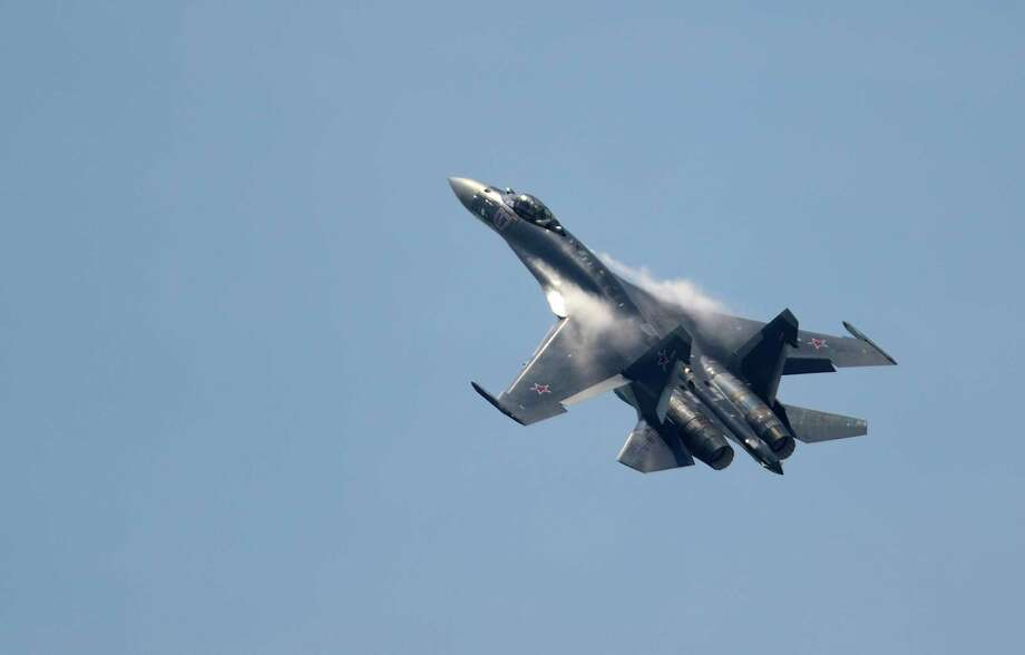 The Paris Air Show, which opened Monday, is a chance for aerospace companies to show off their latest and greatest military planes, airliners, helicopters and more. Here, a Russian Sukhoi SU-35 makes a big noise in its Paris debut on Monday. Photo: ERIC FEFERBERG, AFP/Getty Images / 2013 AFP