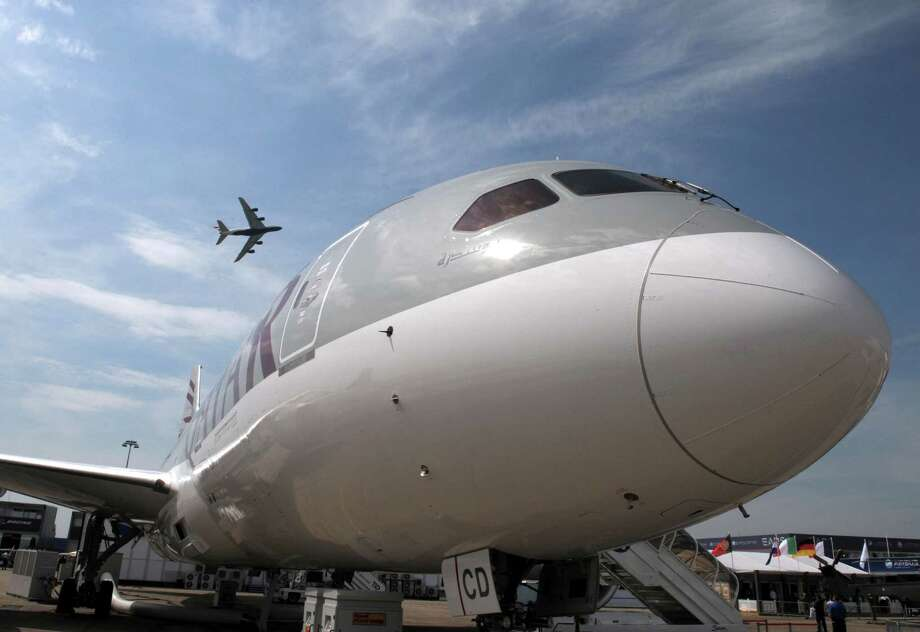 A British Airways Airbus A380 flies over a Qatar Airways 787 Dreamliner at Le Bourget airport, north of Paris, on June 17, 2013, on the opening day of the Paris Air show. Photo: AFP, AFP/Getty Images / 2013 AFP