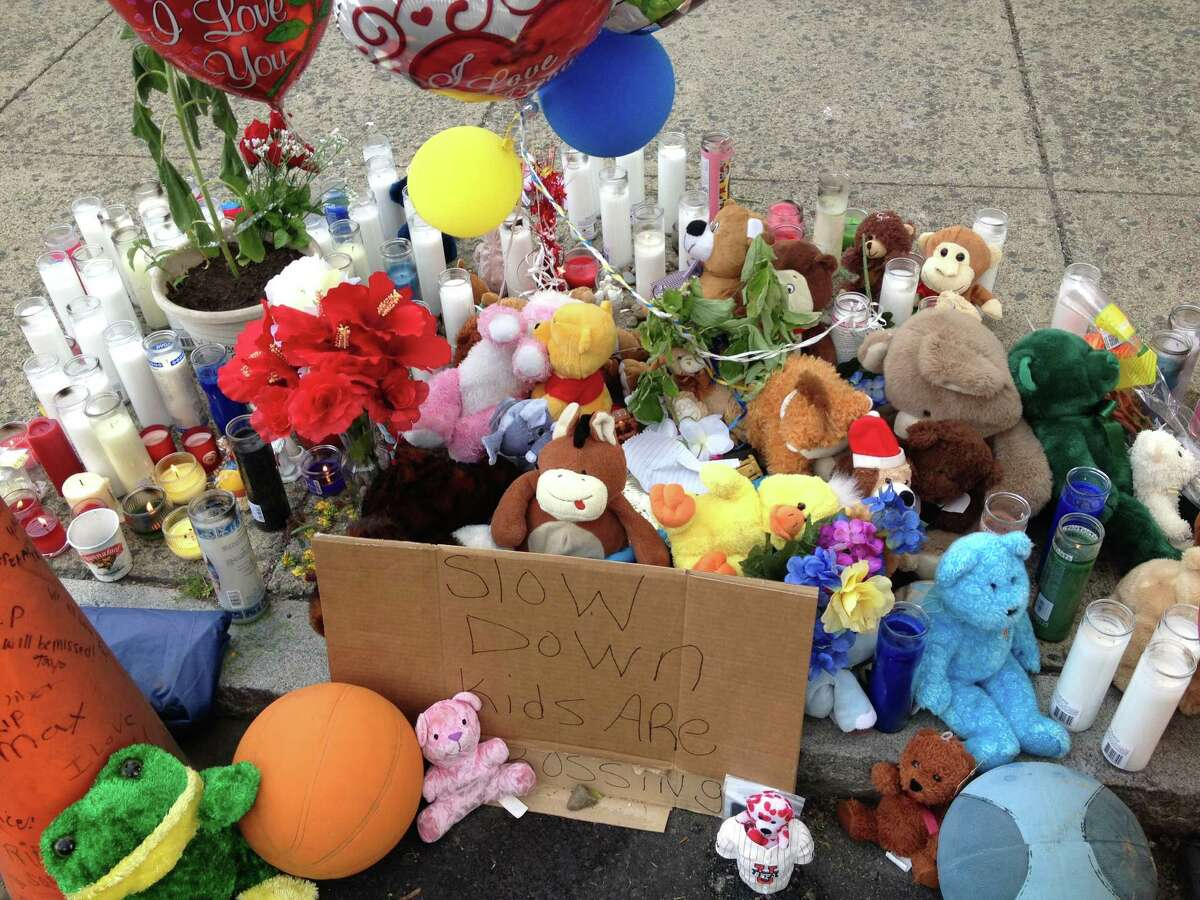A memorial for Qazir Sutherland, the 7-year-old boy who died after he was hit by a car on South Pearl Street on Saturday is being built in front of 628 South Pearl St. (Bryan Fitzgerald / Times Union)