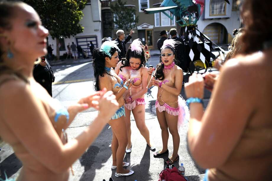 Hot Pink Feathers members get ready on Bryant St. before the start of the 35th annual Carnaval parade in the Mission District of San Francisco on May 26th, 2013.