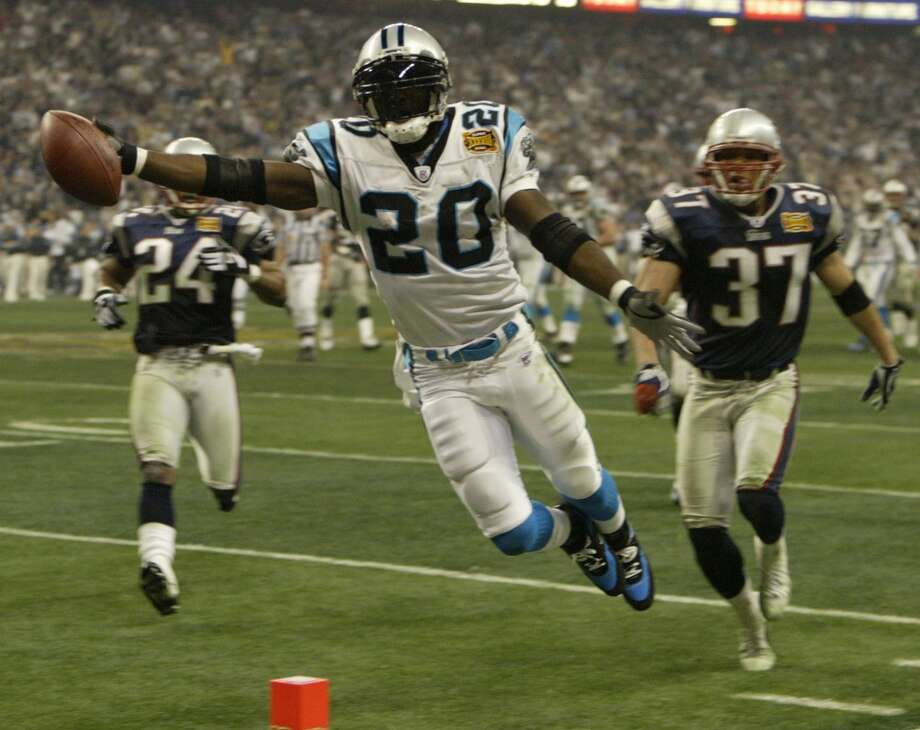 Carolina running back DeShaun Foster dives into the endzone during the fourth quarter.