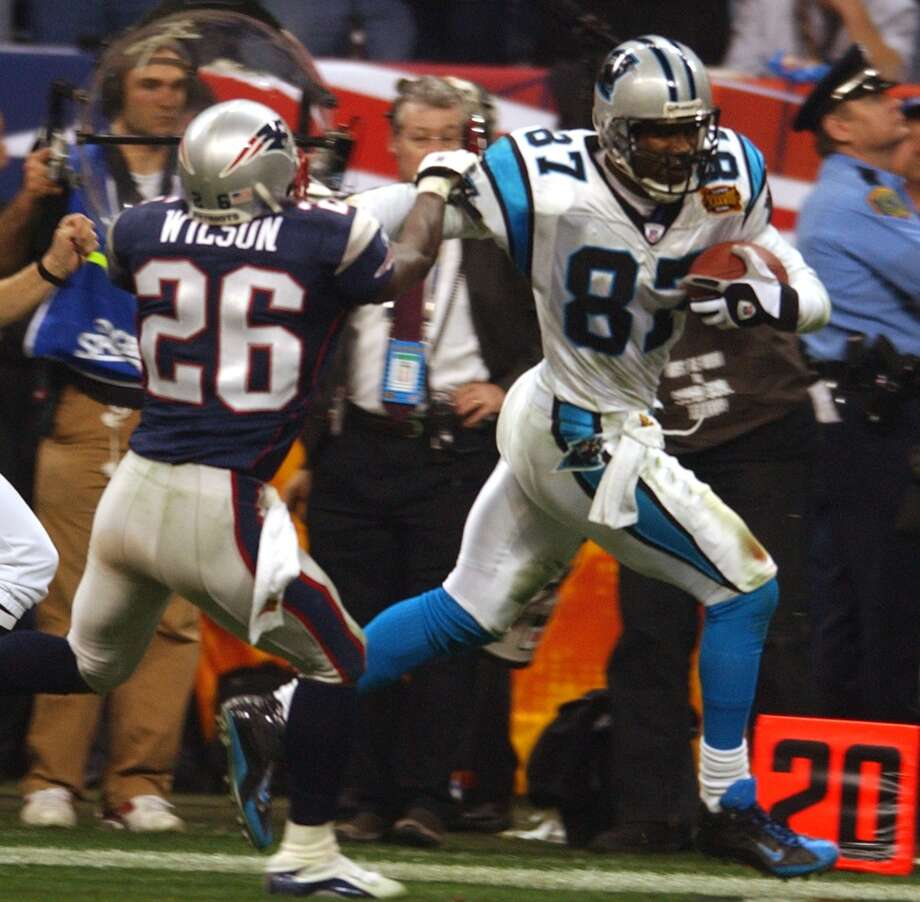 Mushin Muhammad (87) runs for a  85 yard TD past Patriots Eugene Wilson (26) during 4th quarter putting the Panthers ahead 22-21.