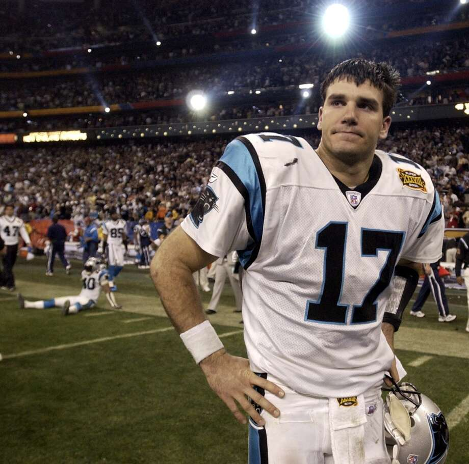 Panthers quarterback Jake Delhomme (17) walks off the field after losing Patriots 32-29.
