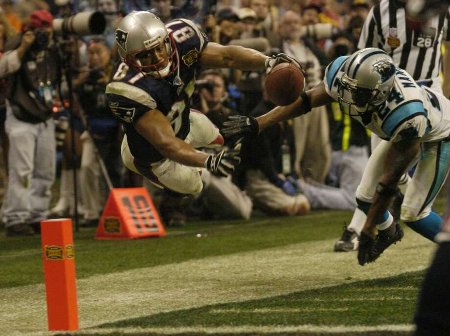 Patriots receiver David Givens dives for the endzone in the 4th quarter with Panthers defender Ricky Manning Jr. defending.