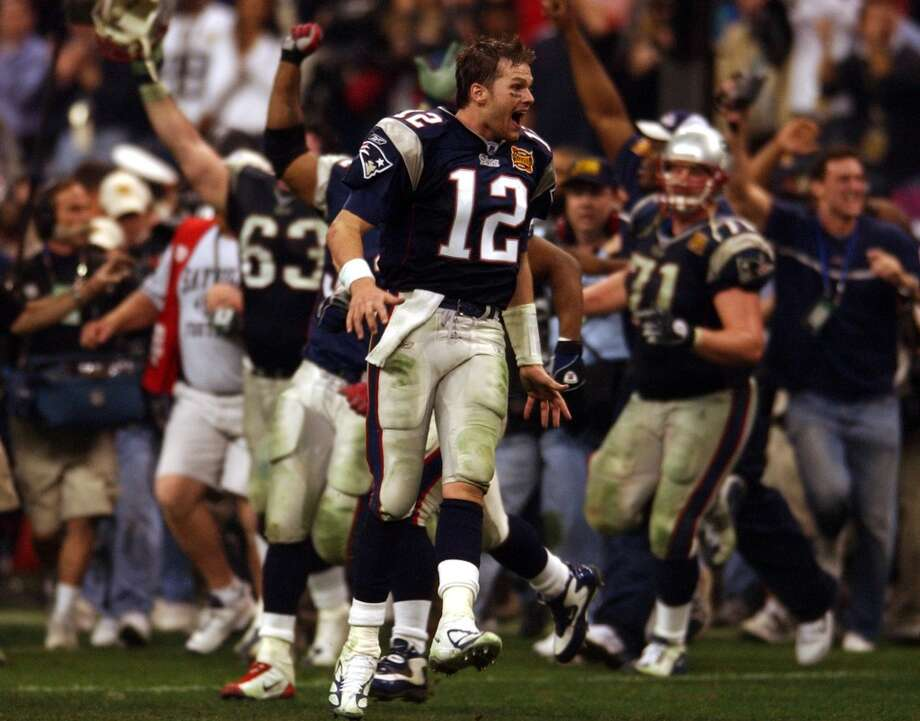 Patriots quarterback - and Super Bowl MVP - Tom Brady (12) joins his teammates in celebrating their victory.