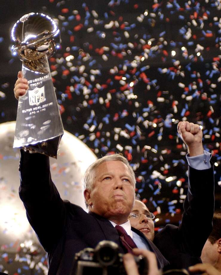Patriots owner Bob Kraft holds up the Vince Lombardi Trophy.