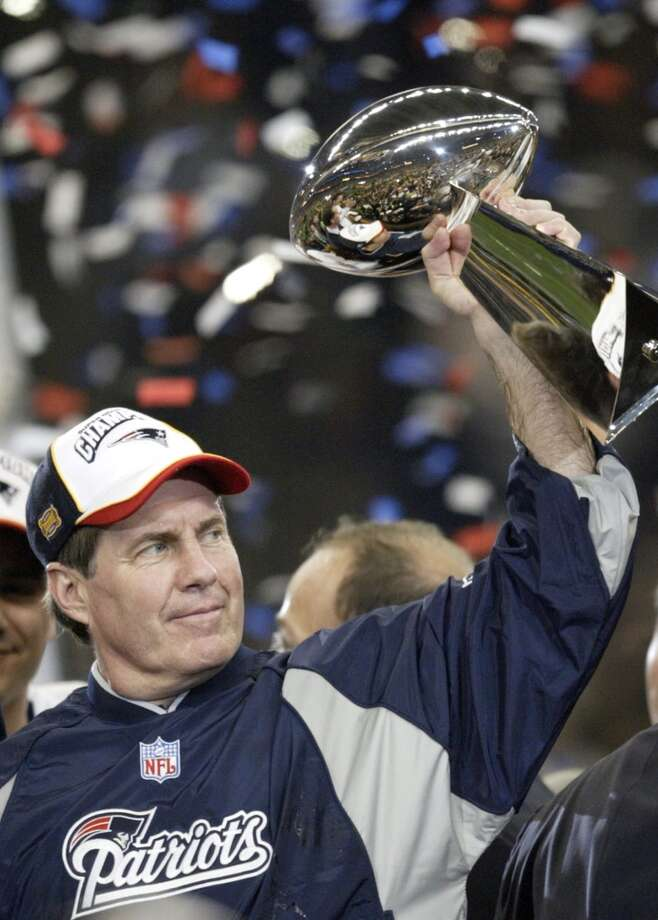 Patriots coach Bill Belichick holds the Vince Lombardi trophy.